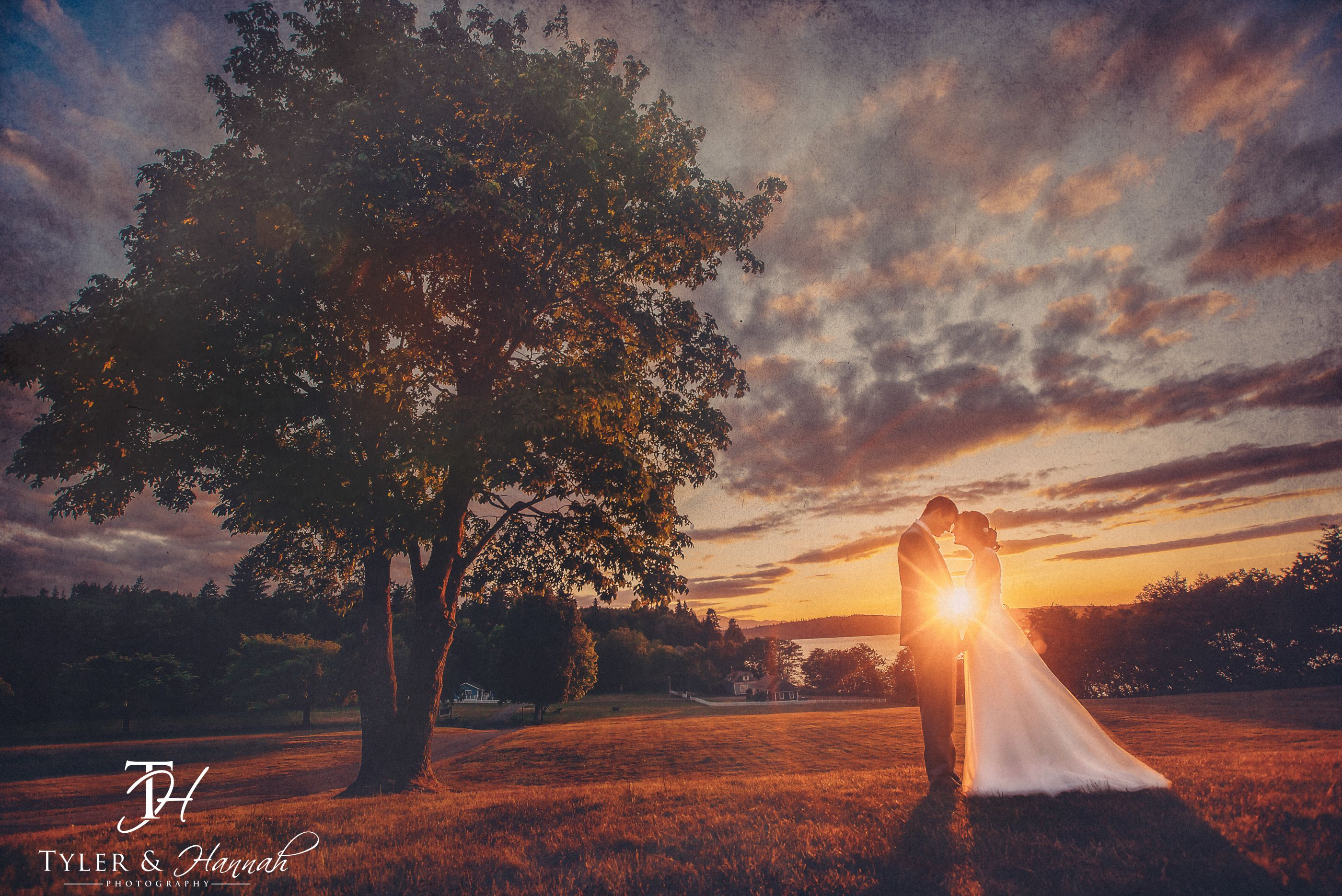 Bride and Groom portrait at beach sunset wedding at the Port Gamble Pavilion, WA by Tyler and Hannah Photography