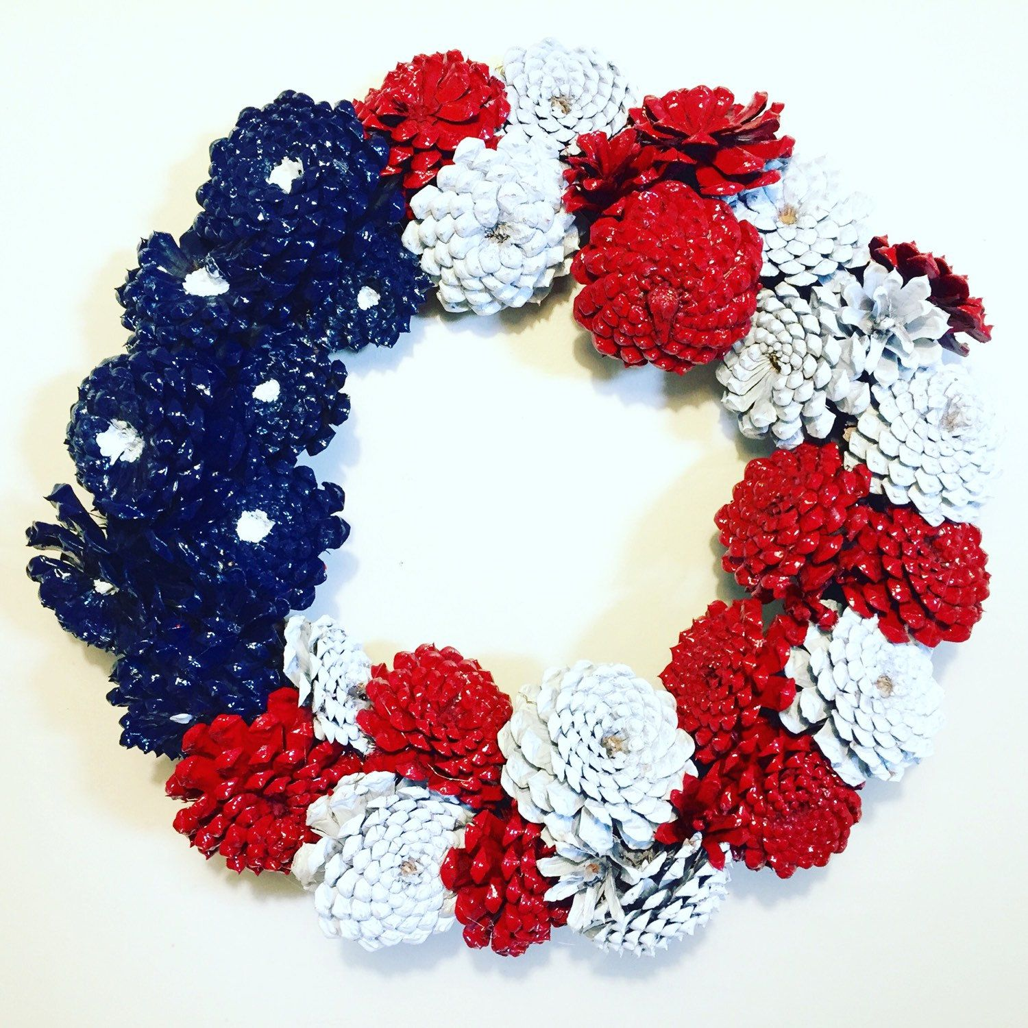 SouthernEscentuals shared a new photo on -   23 pinecone crafts white