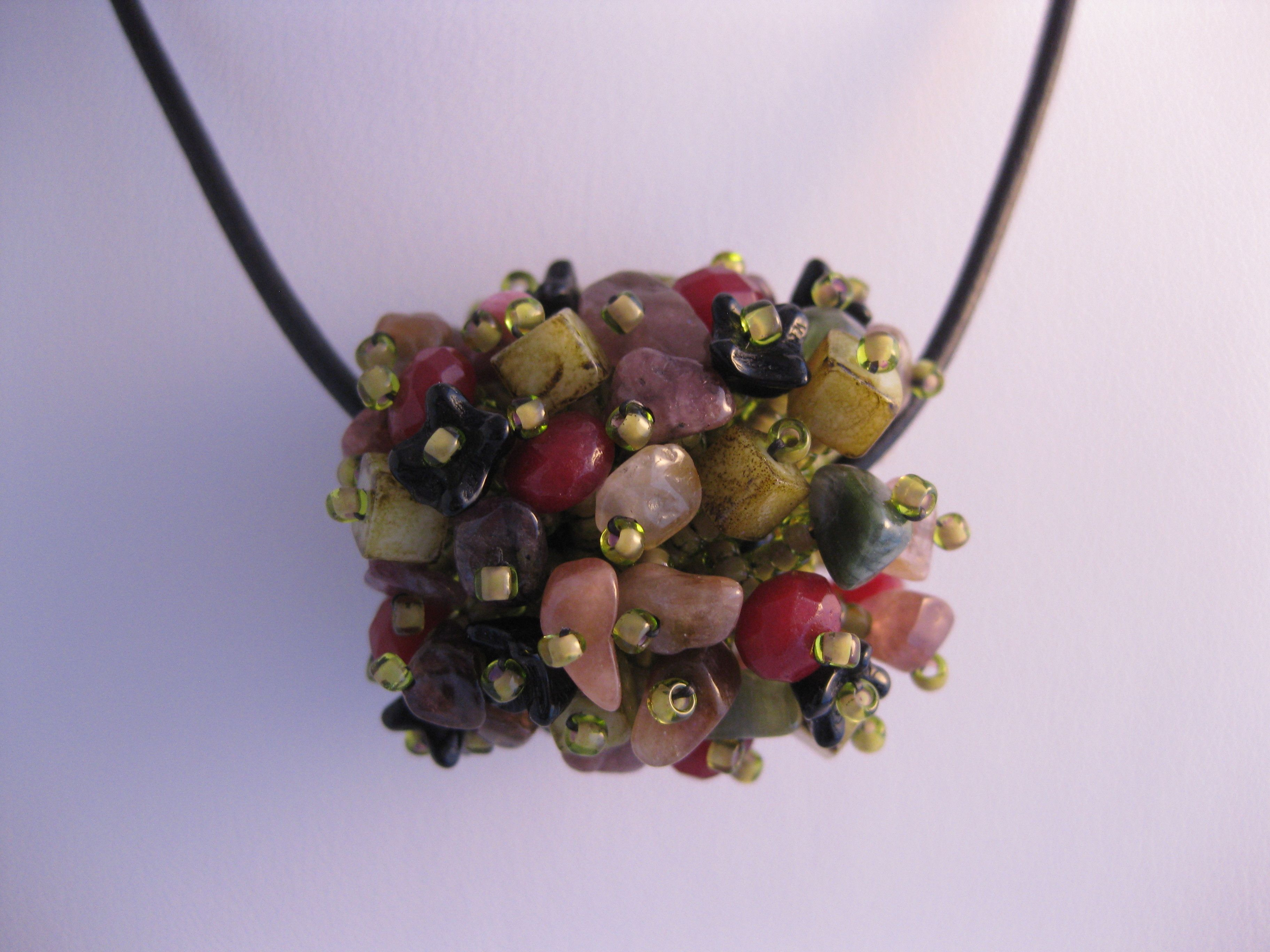 Beaded bead in tourmaline.