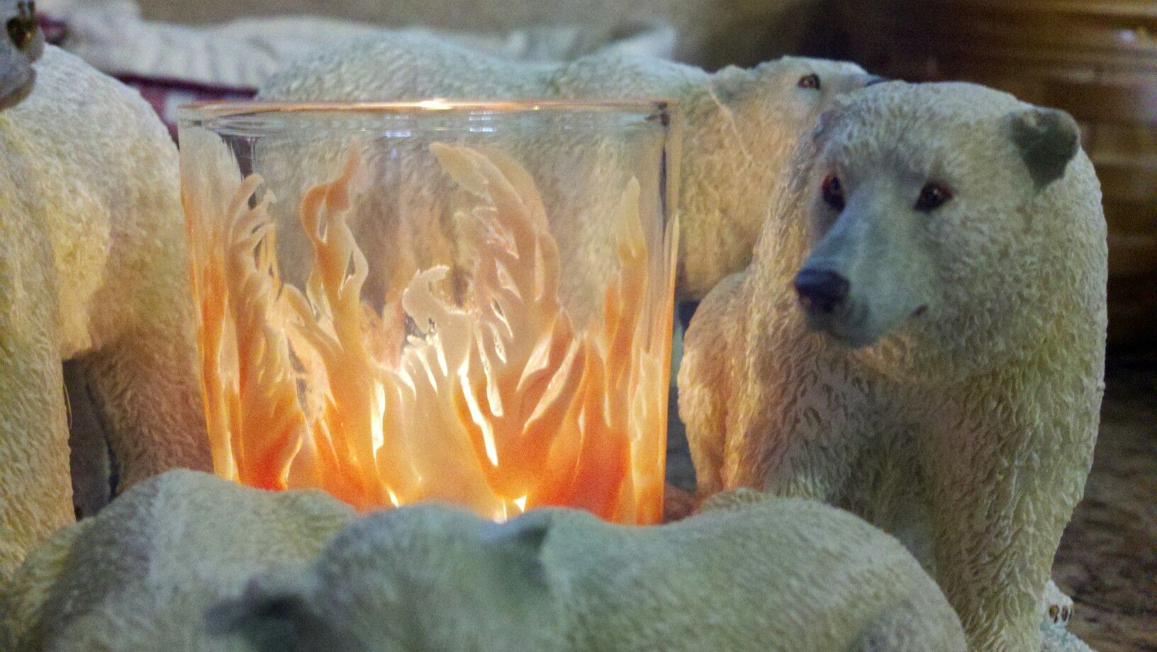 Polymer clay flames up the side of a votive with an LED candle inside.