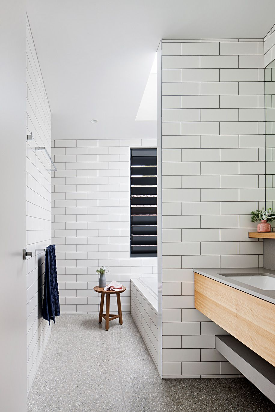 Home tour a summer abode in victoria crisp white bathroom with home tour a summer abode in victoria crisp white bathroom with oversized subway tile bathroom pinterest subway tiles house and bath room dailygadgetfo Image collections