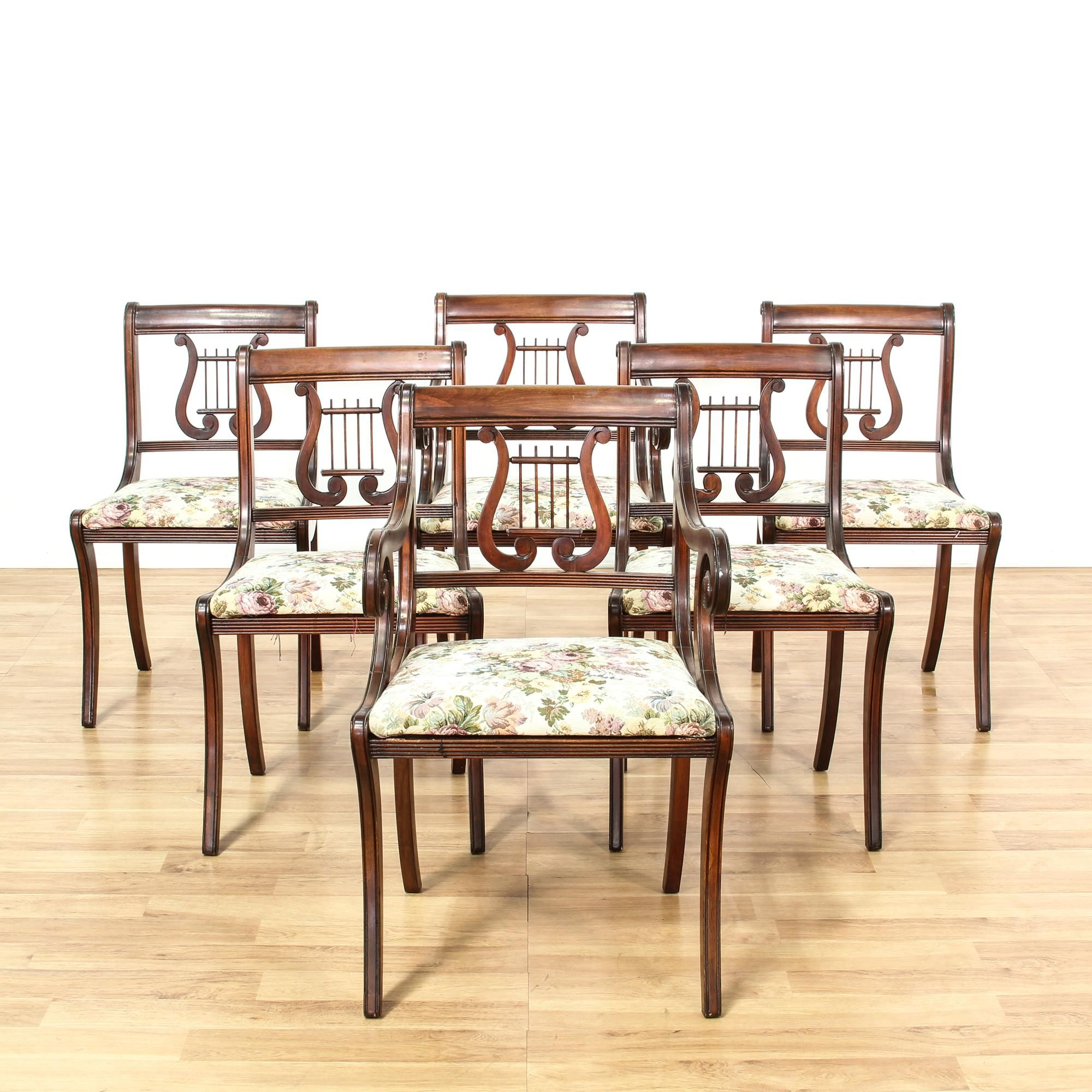 This set of 6 Duncan Phyfe dining chairs are featured in a solid