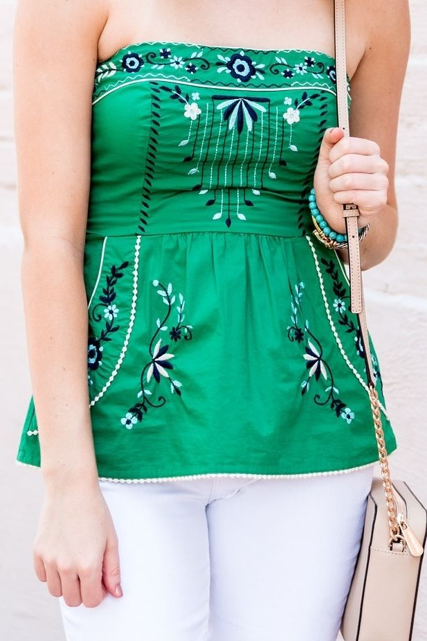57713f5720a3 Fashion blogger Ashley Nudge wearing green strapless embroidered top - The  Ashley Edit