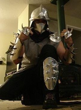 shredder halloween costume for the hubs made out of chicken wire and a whole lot of aluminum tape