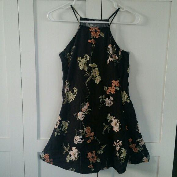 Brandy Melville black floral abigail dress Flaw shown in picture (light black/gray streak on bottom of dress) Brandy Melville Dresses Mini