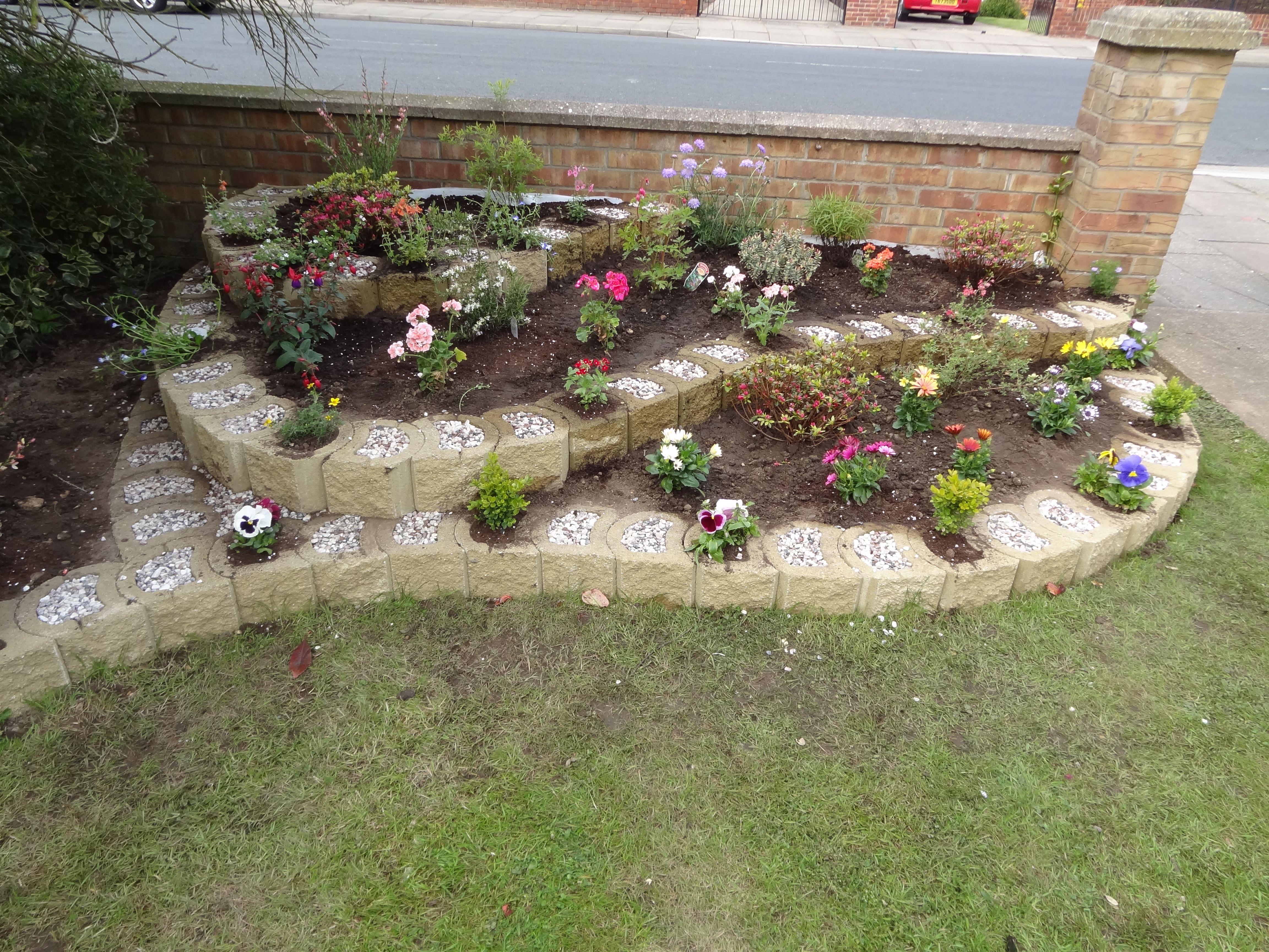 Raised Flowerbed Created With Mortarless Reversible Interlocking