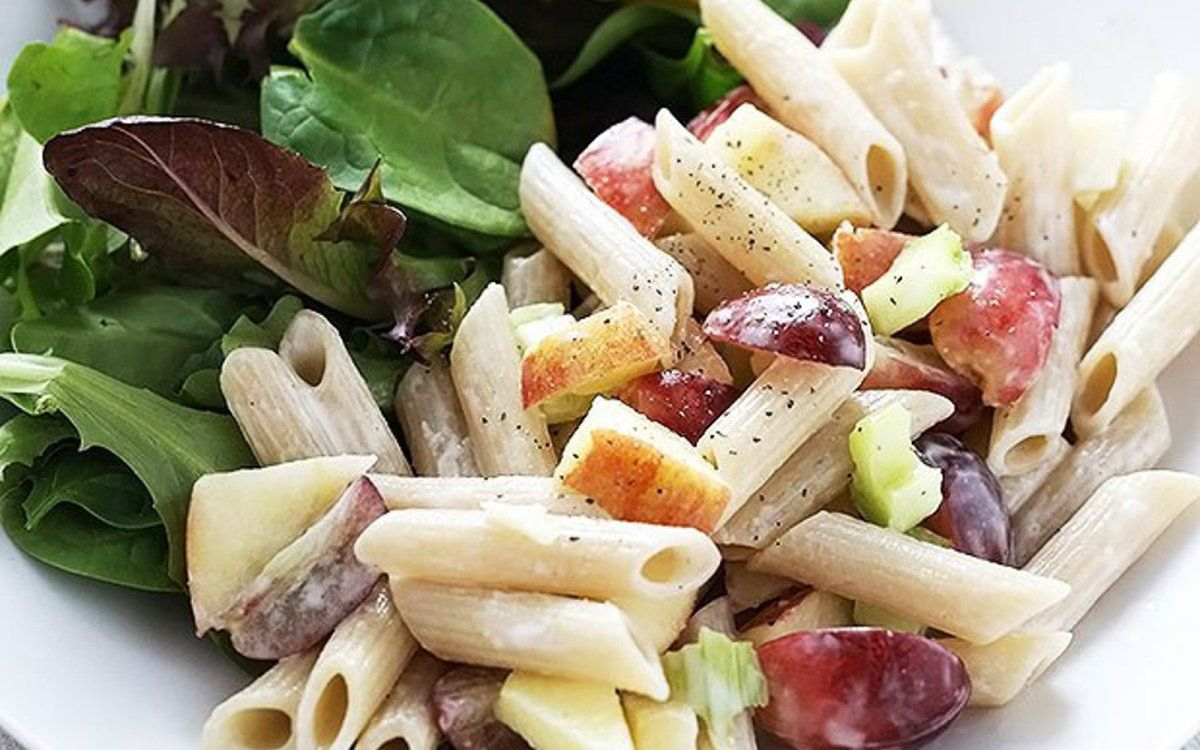 Pasta is tossed lightly with vegan mayonnaise for a creamy base, and then the grapes and apple provide small bursts of sweet freshness.
