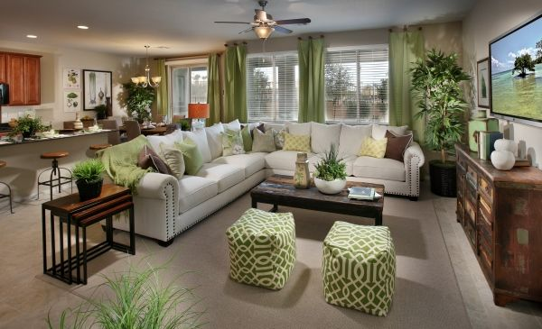 We Love The Pops Of Green Used To Decorate This Living Space From Lennar Las Vegas What Are Your Thoughts Home New Home Communities Home Living Room