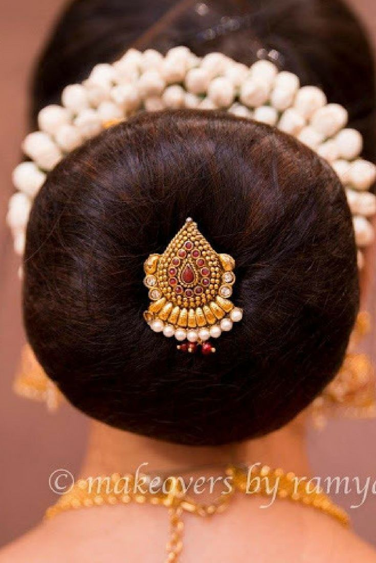 What a beautiful large low bun with gajra & juda pin! Care however should be taken before ...