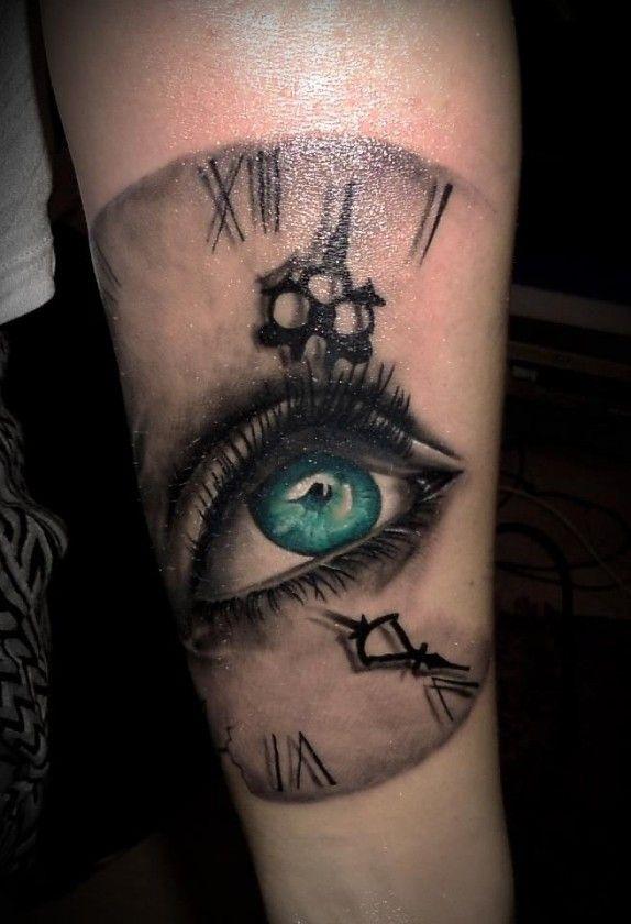 Realistic Eyeball Tattoos   eye-on-the-time-realistic-tattoo-by-2nd-Face-Tattoo-574x840.jpg