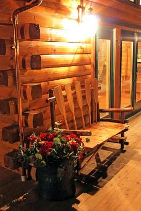 Log Home Porch At Night.....bench Back Is Made Of Oars