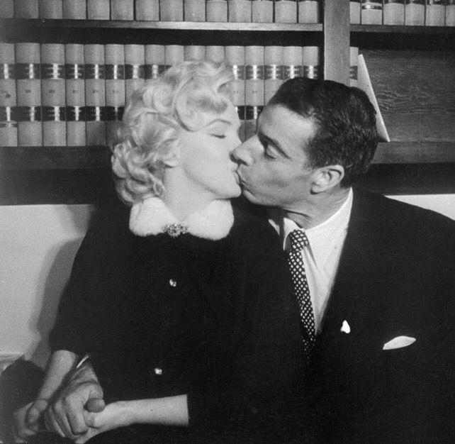 Marilynkissing Husband Joe DiMaggio in judges Chambers City Hall, San Francisco;1954