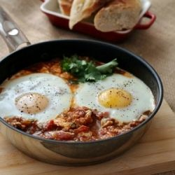 Spicy baked eggs - Fast and easy to cook ! Made with fresh cherry tomatoes , spicy chorizo and eggs .