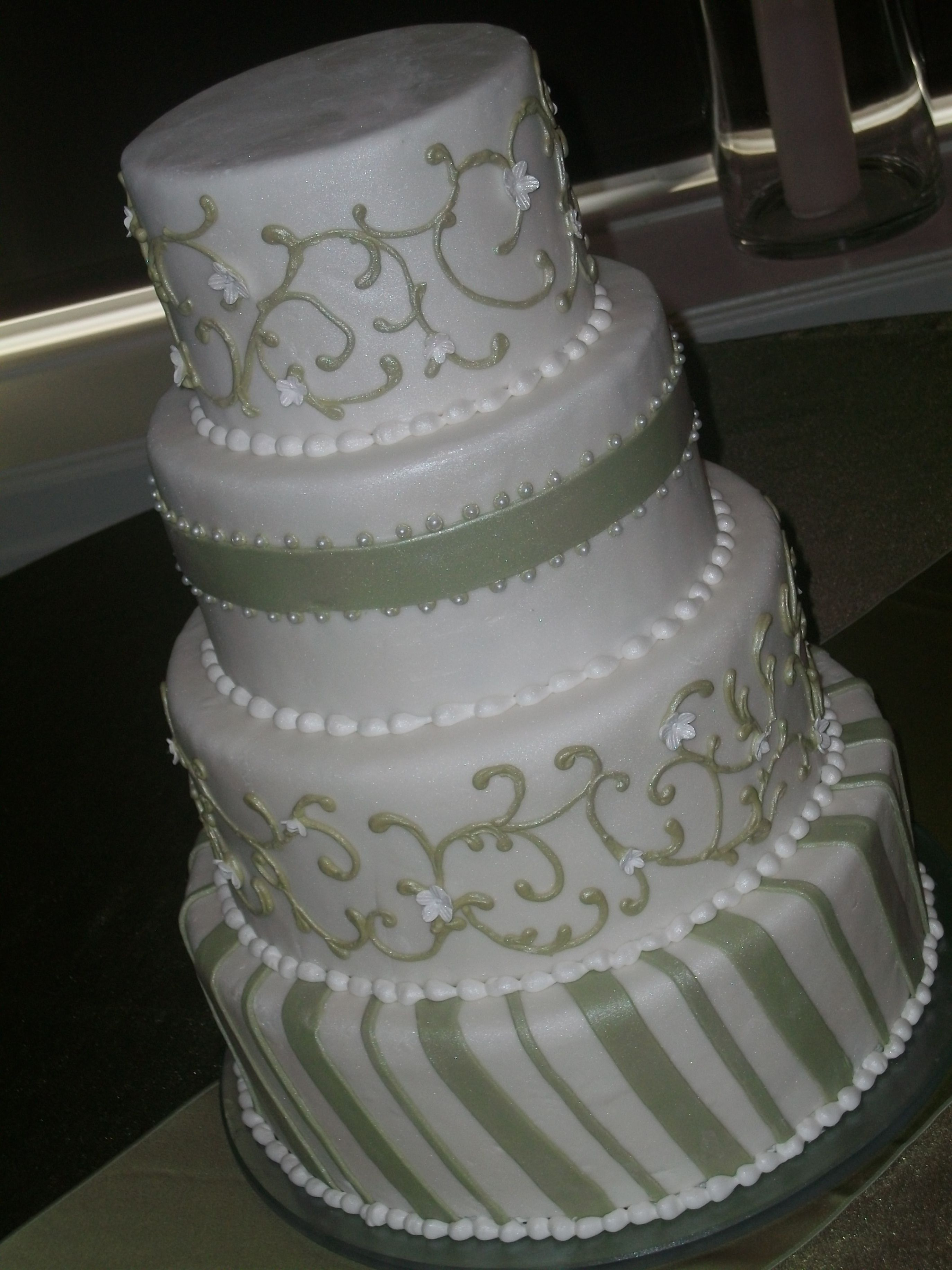 Classic style wedding cake with green accents. Wedding cakes, 4 tier cakes, http://tiered-expressions.com