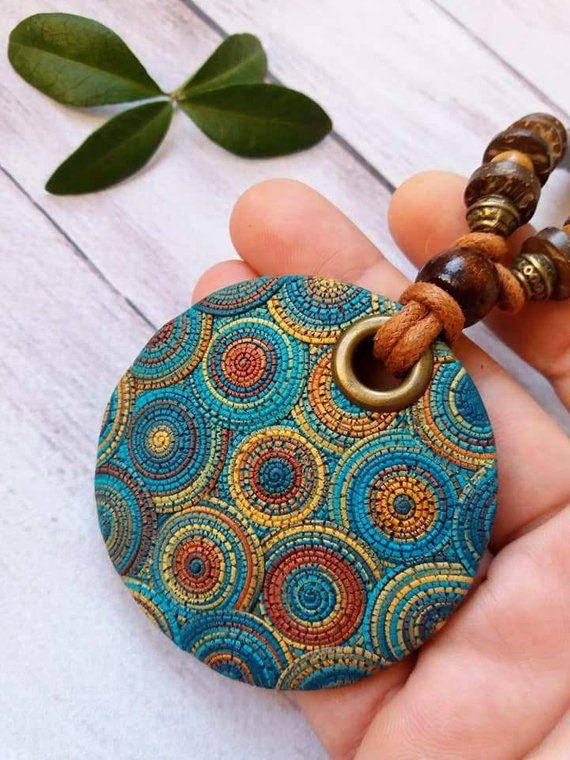 Stylish necklace with a bright geometric pattern in boho style