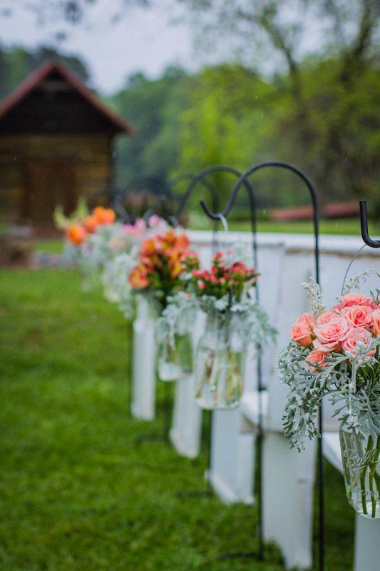 rustic wedding ceremony  mason jars on shepherds hooks   each a