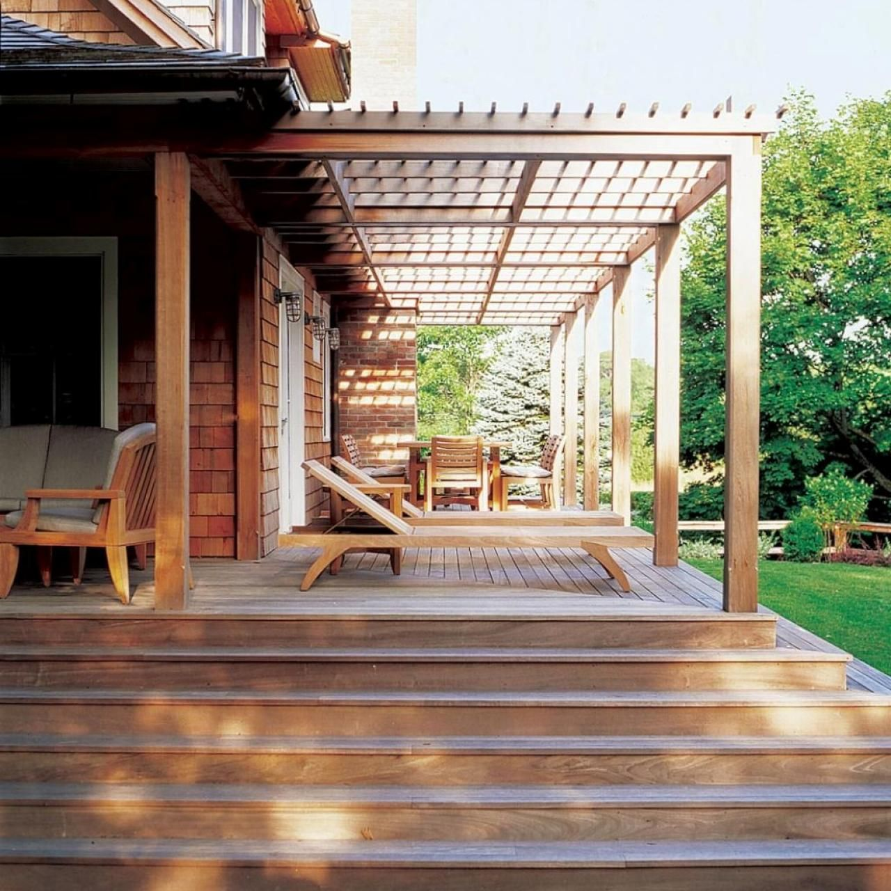 Attaching deck to house with siding - Bungalow Features Wood Deck And Attached Pergola Hgtv