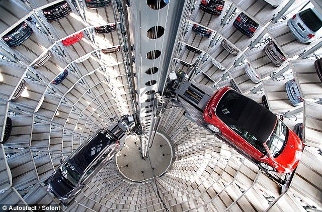 The ultimate high-rise garage: 600 new cars packed into tower with a  robotic arm as they wait to be delivered to buyers | Car showroom,  Volkswagen, Used cars