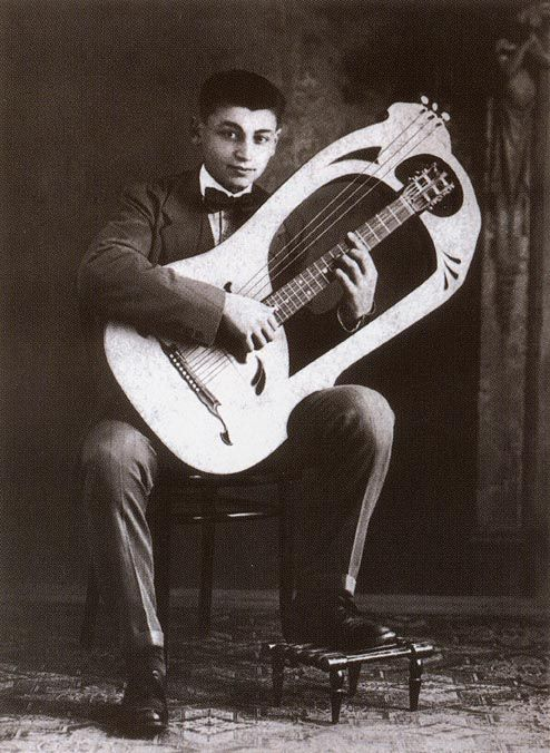 A very young Mario Maccaferri (1900 - 1993) plays his Mozzani Harp Guitar