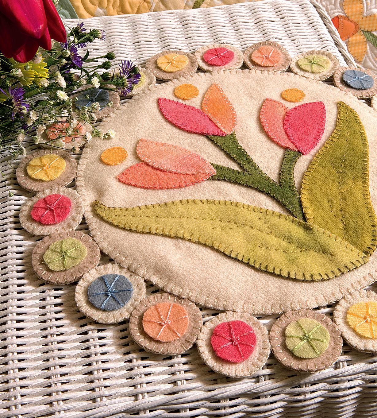 Fanciful flowers and pretty pennies - download the Spring Penny Rug pattern by Julie Popa for free when you sign in or register at our site, ShopMartingale.