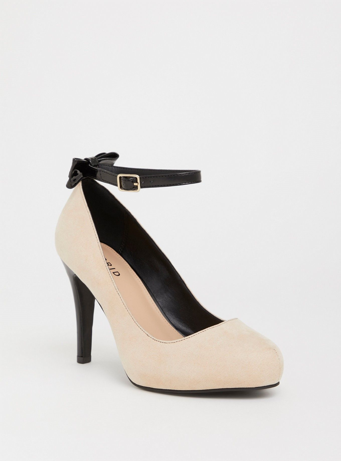 4bdb191fff9 Nude Faux Suede Pump With Patent Bow (Wide Width) - A patent faux leather  bow adorns a high heel pump for a bold feminine detail.