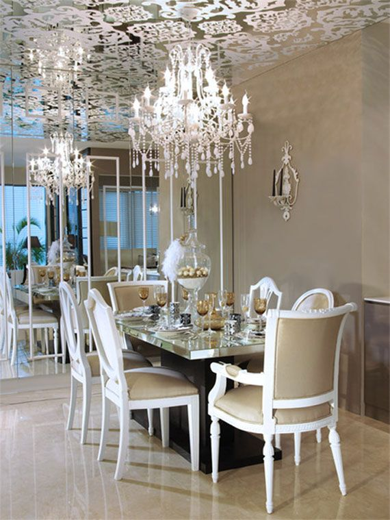 Dining Room With Mirrored Ceiling And Chandeliers