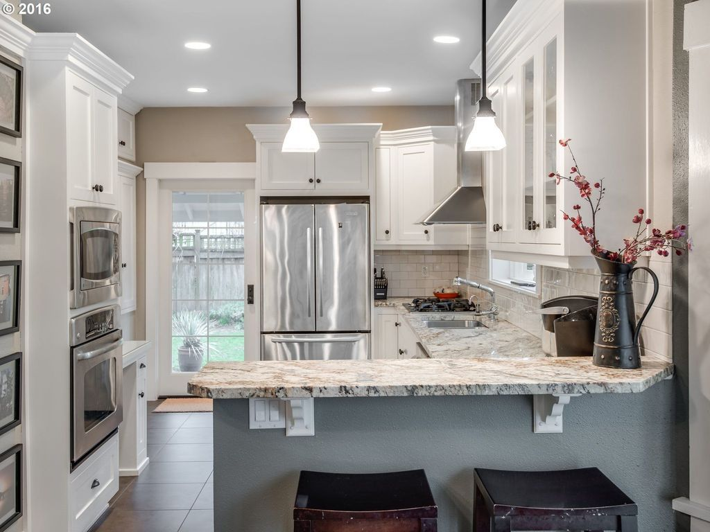 traditional kitchen with flat panel cabinets pendant light complex rh pinterest es