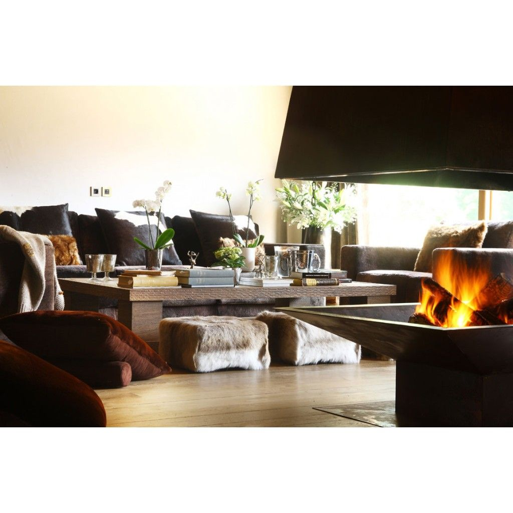 When winter is coming, covering your furniture with fur cover and set the fireplace in order to brings the warmth! #rumahkulivingroom