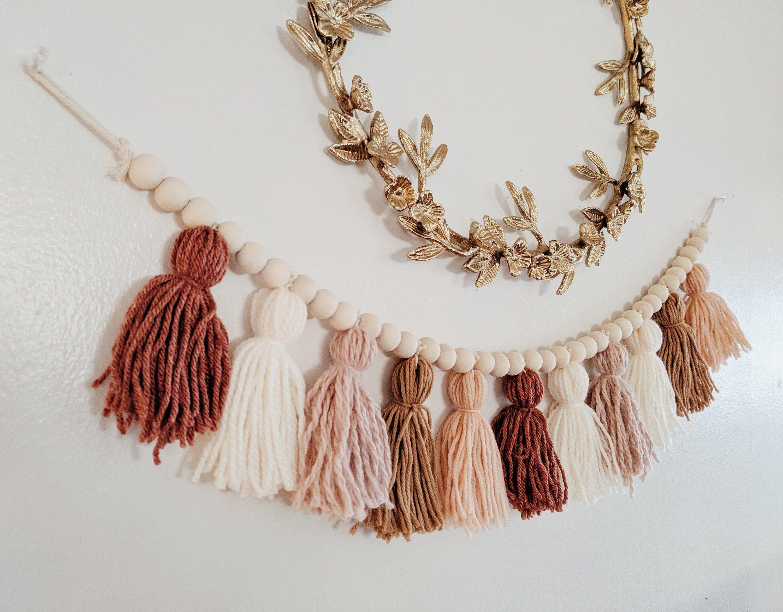 Blush and terra cotta yarn tassel garland with wood beads / Earth tone wall art / Over the crib / Neutral decor