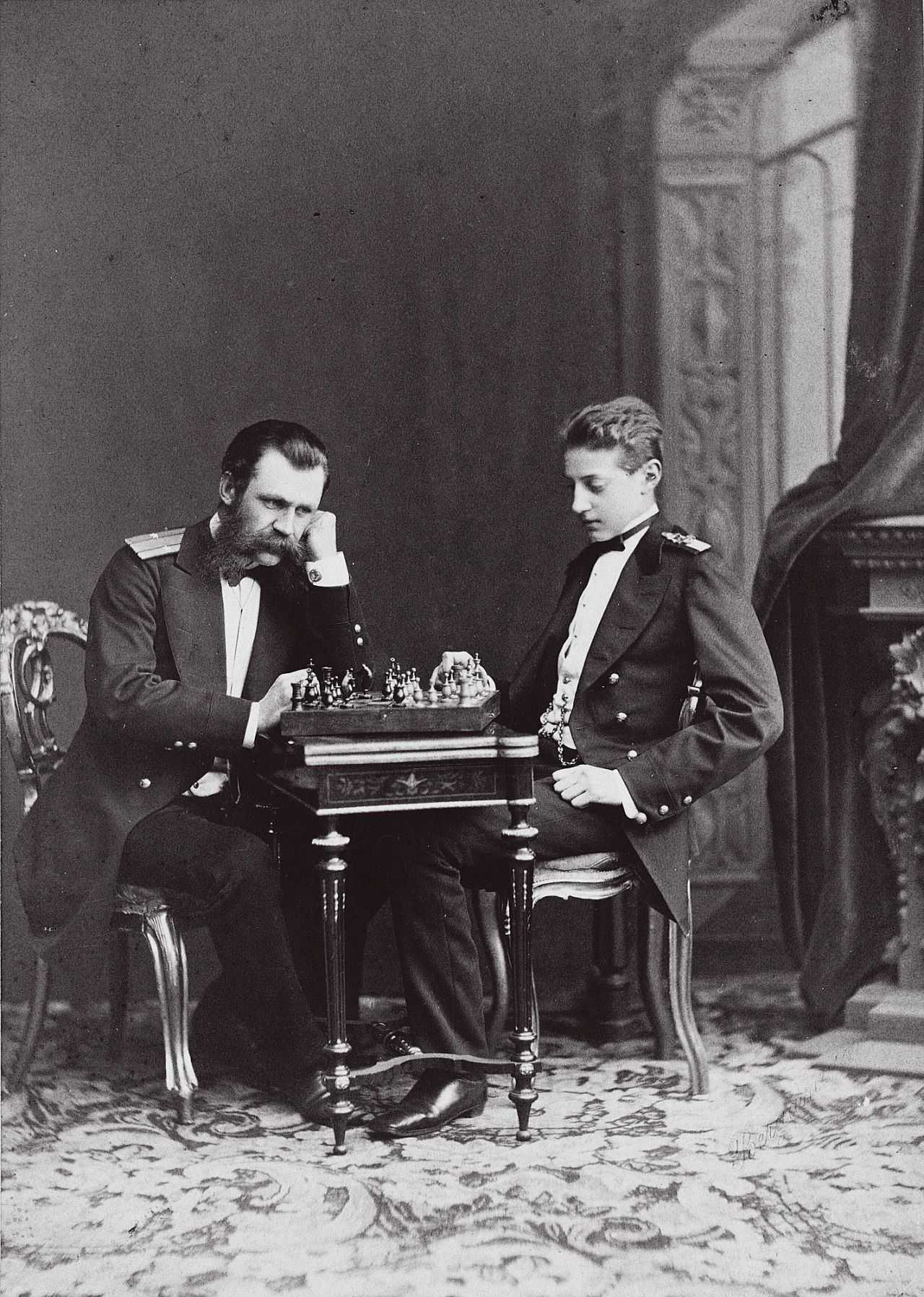 """Grand Duke Konstantin Nikolaevich engaged in a game of chess with one of his tutors """