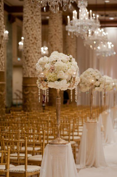 Wedding Ceremony Set Up With Chandeliers And Tall Centerpieces