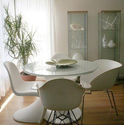 Budget version of Saarinen tulip table: Ikea Docksta with added glass top. I like!