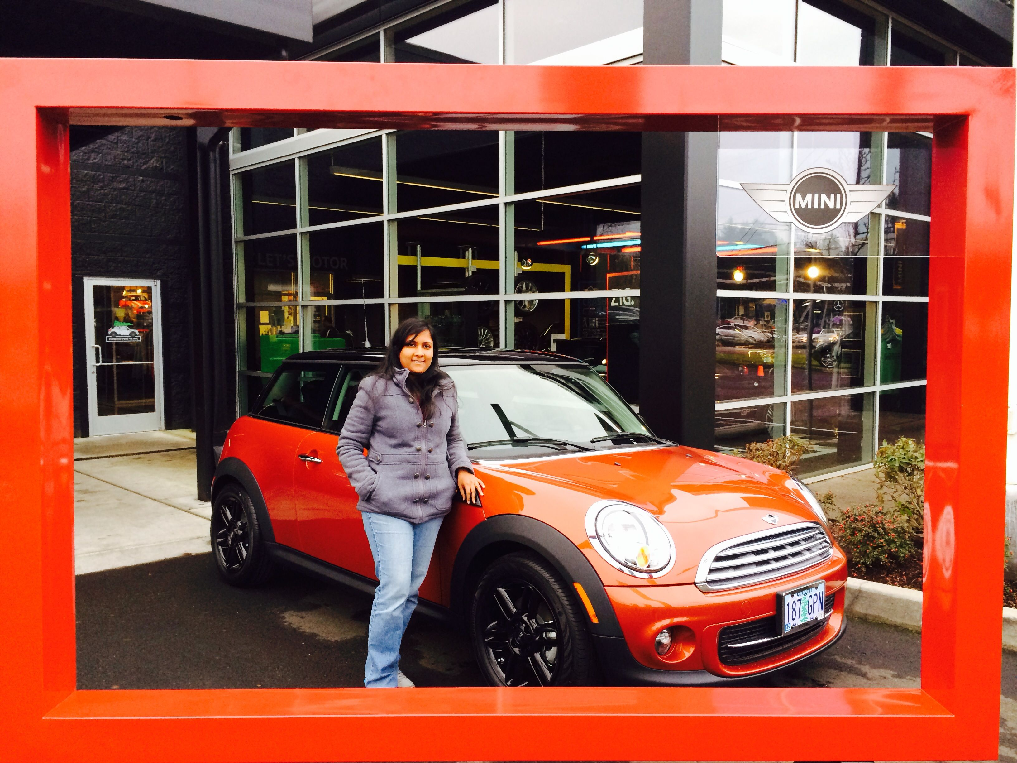 Priyam looks great next to her new MINI and that Spice Orange is