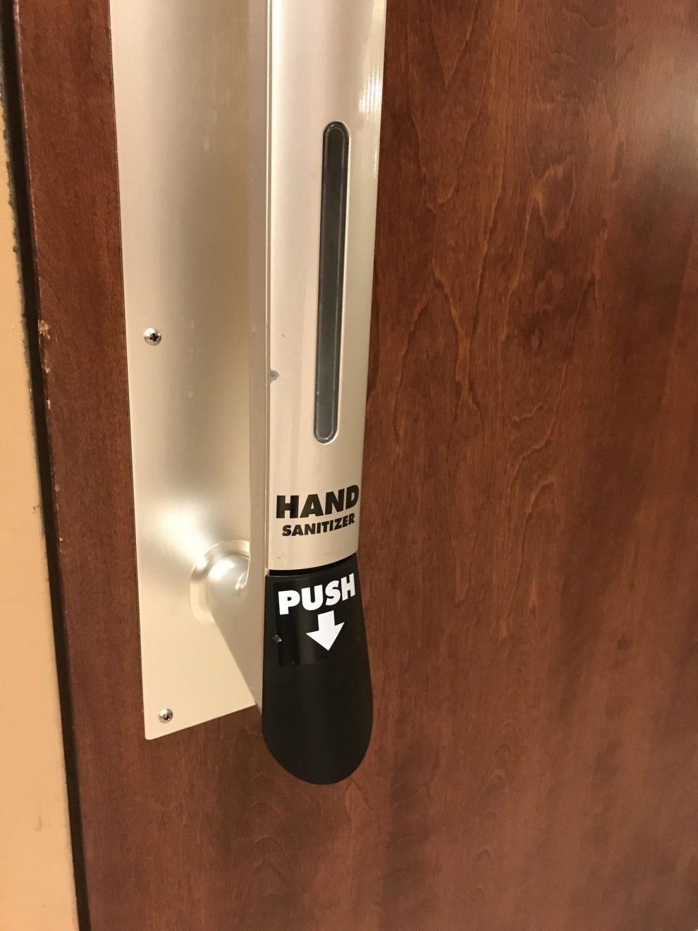 This Hand Sanitizer Dispenser Attached To A Bathroom Door Handle