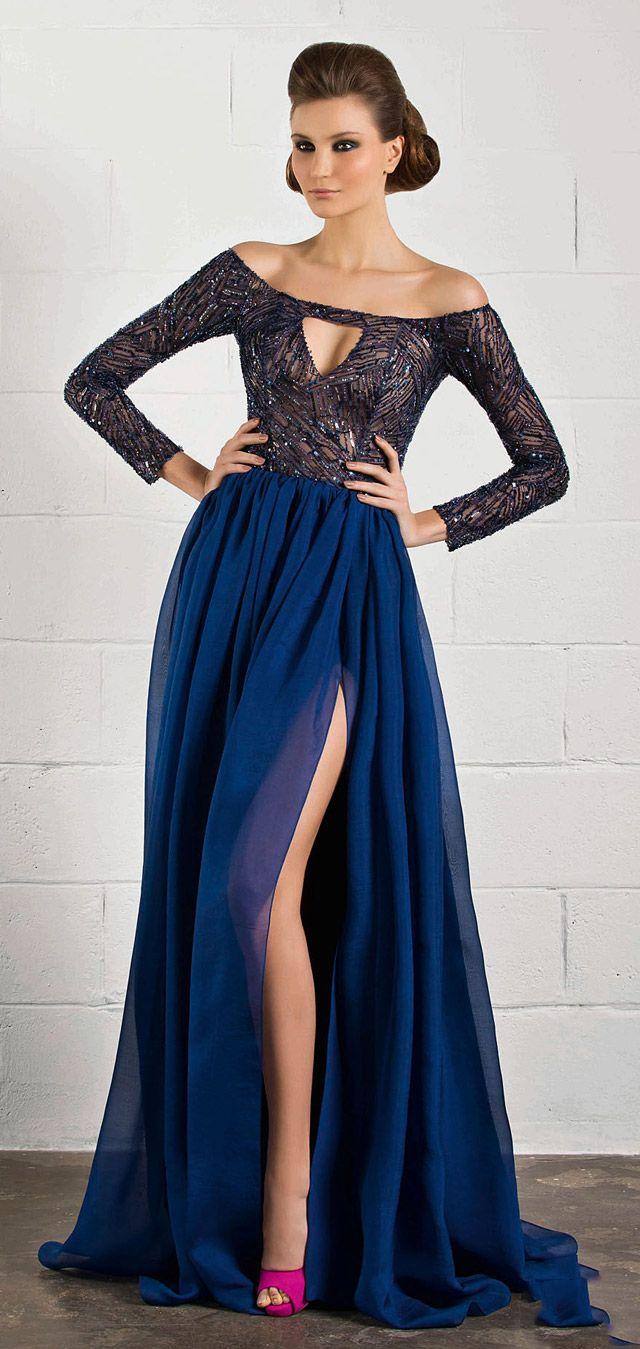Floor length navy blue horn with thigh high slit and silver jeweled