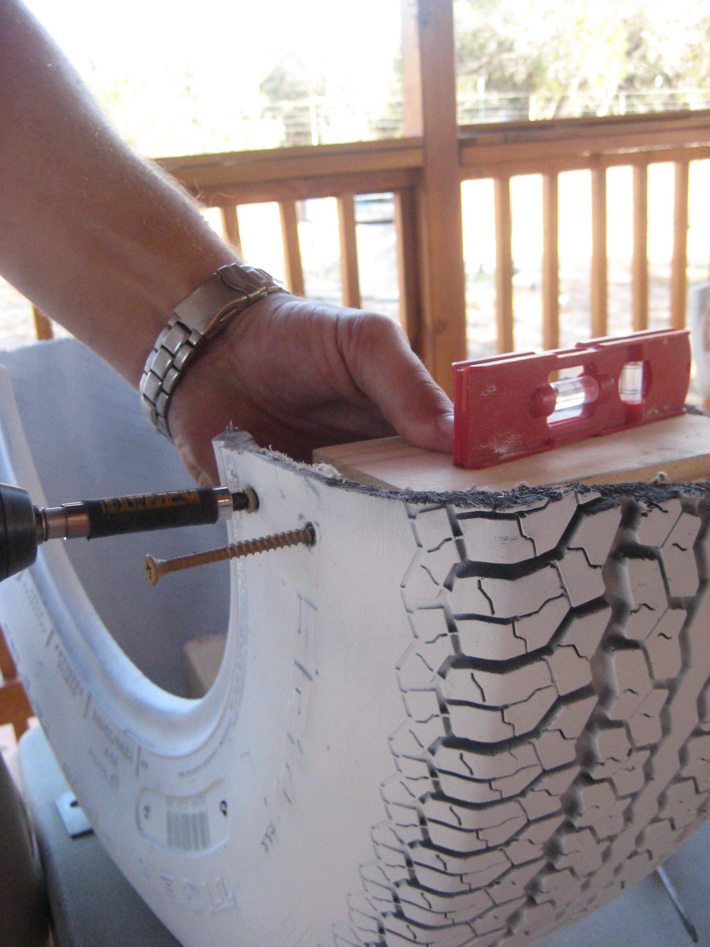 Diy recycled tire rocker aka tire teeter totter tired for Diy tire