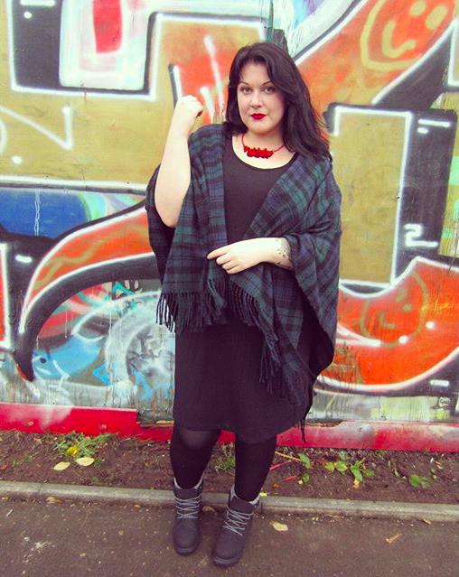 Turn your scarf into a casual shawl! We love how @ikiwnblog added some color to her monochrome outfit! #OwnYourCurves