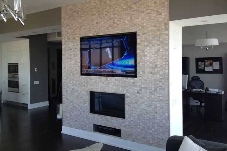Led Tv Wall Mounted Flush To The Surface Of Custom Designed Cultured Stone Above Fireplace