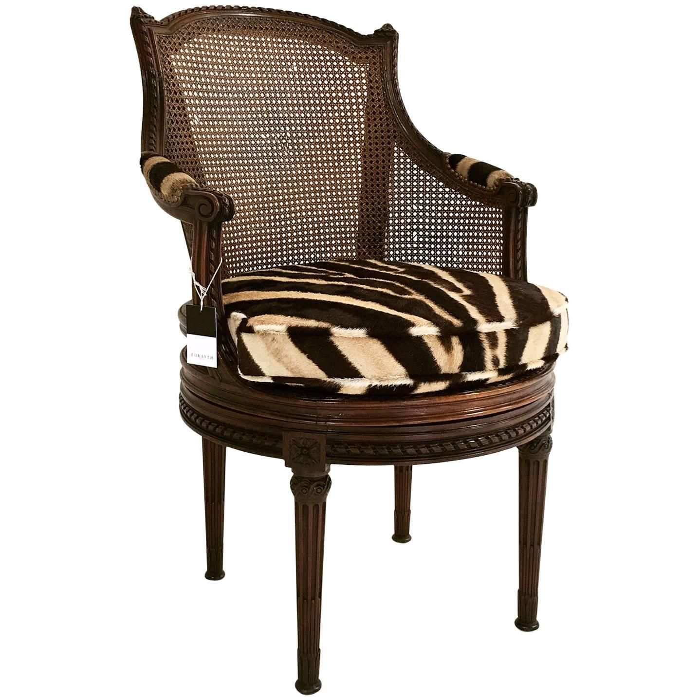 Th century french georges jacob mahogany and cane swivel bergere