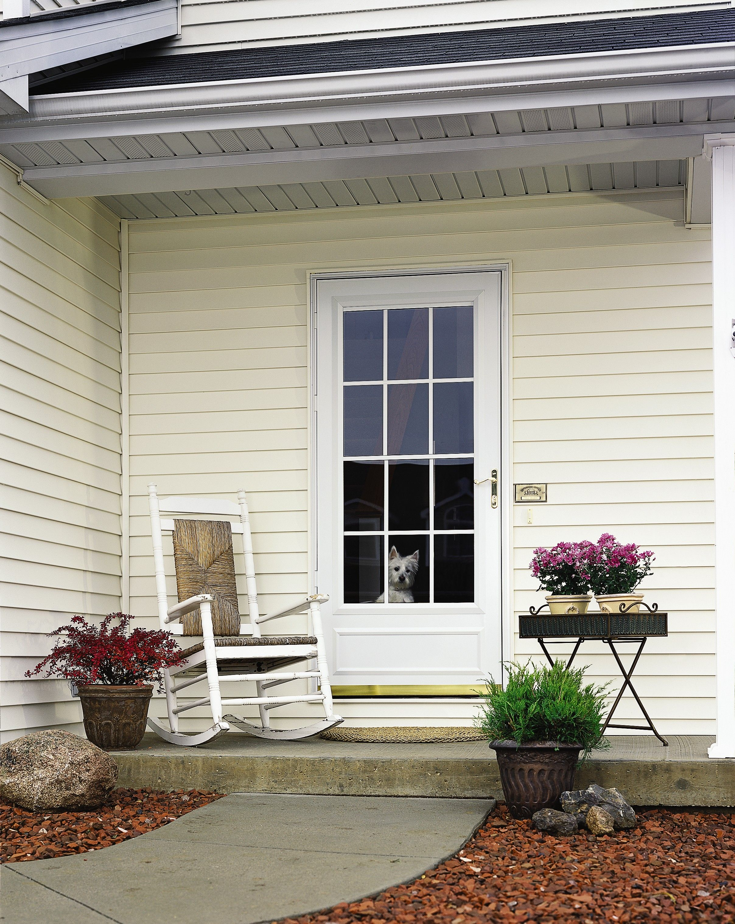 A Retractable Rolscreen On Pella Storm Doors Can Be Pulled