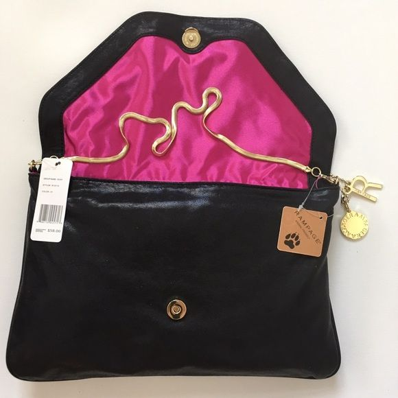 bf64d4d863 Black Rampage purse New Rampage purse. Black vegan leather with gold tone  chain detail and gold chain strap. Hot pink lining with zipper pocket.