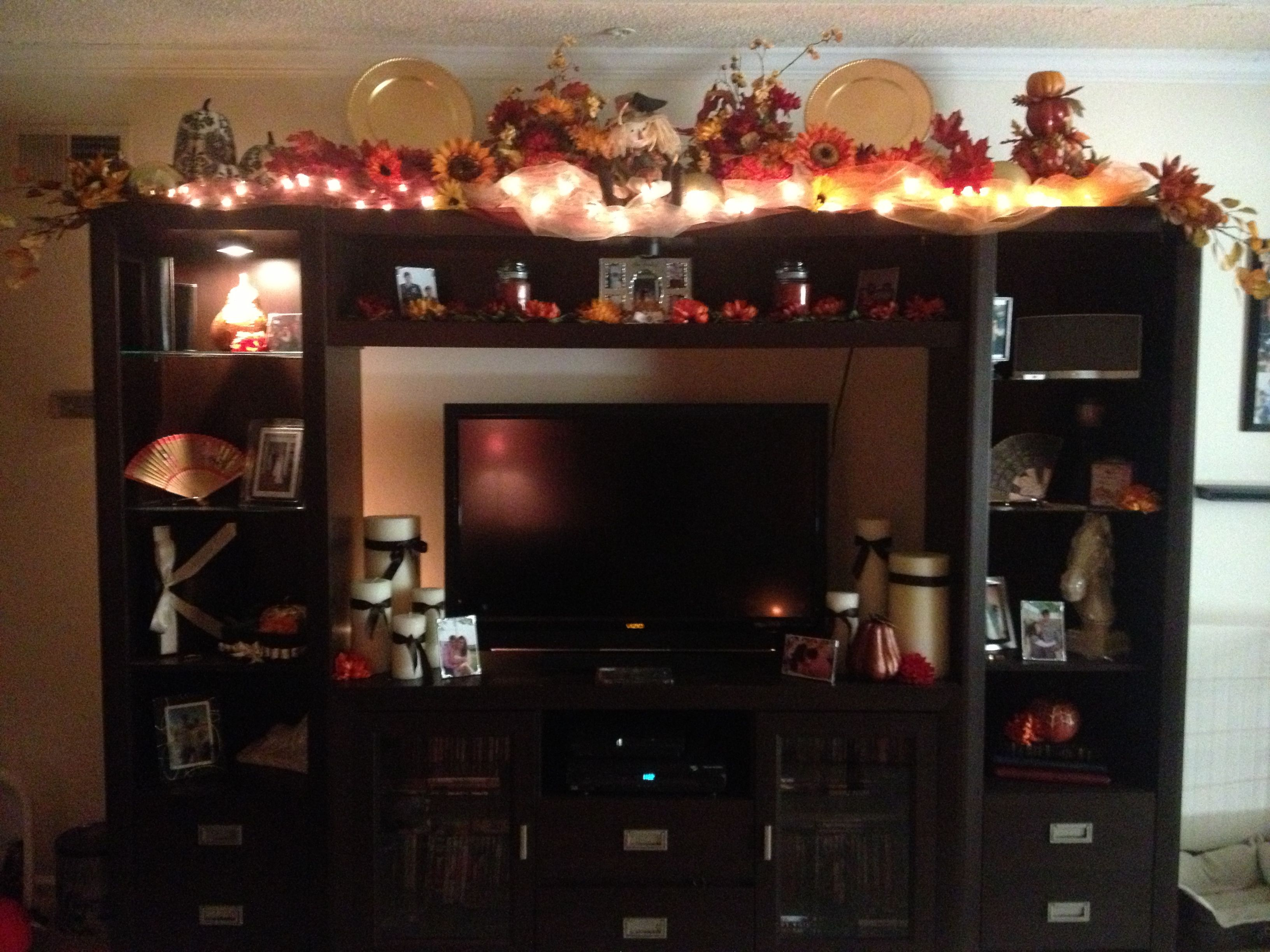 Festive season holiday decor for top of entertainment for Decorating entertainment center ideas
