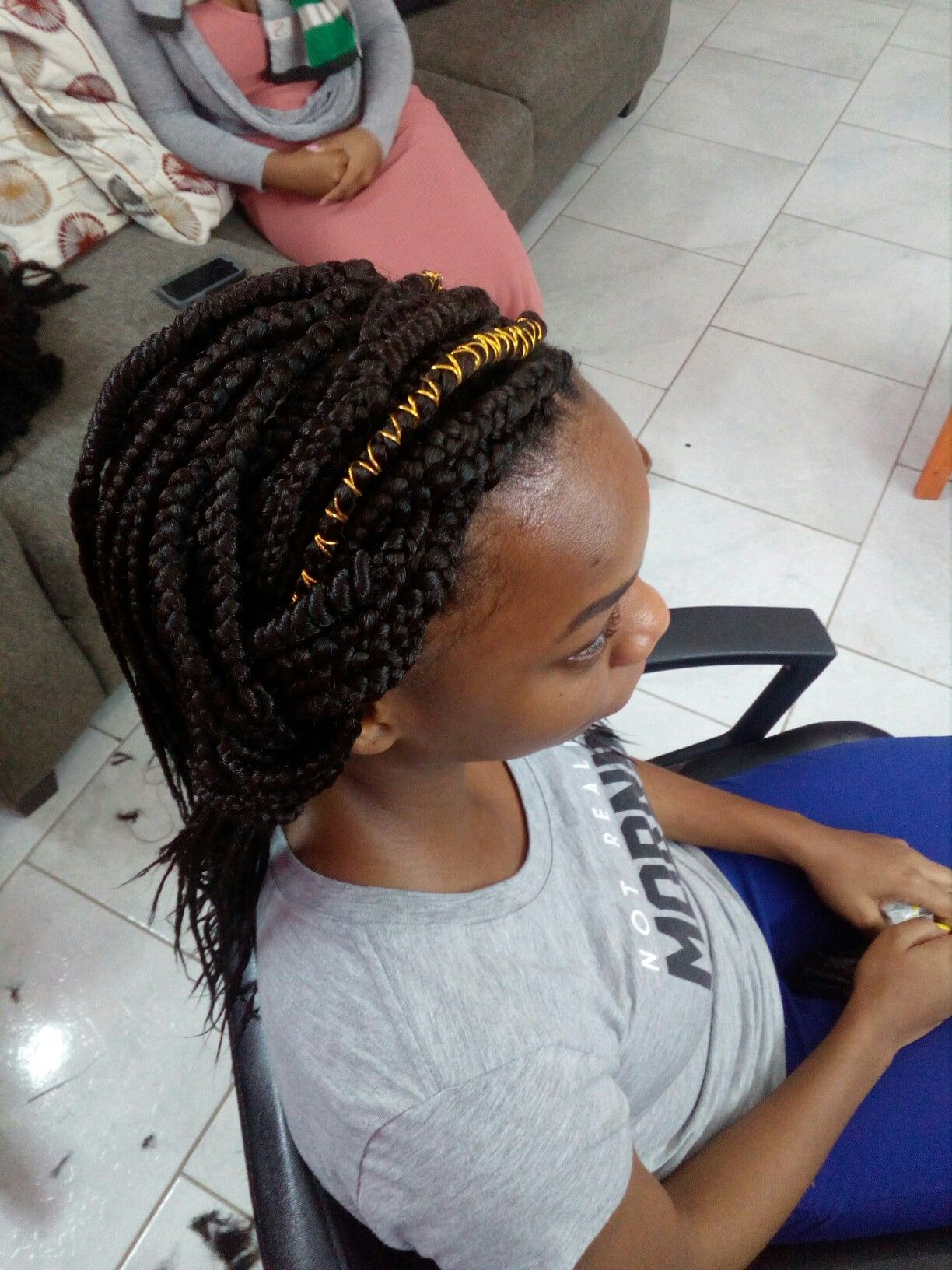 This braided style has versatility1 back to school