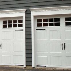 Double Garage Door That Looks Like Two Doors Carriage House Painted Garage Doors Garage Doors Garage Door Trim Steel Garage Doors