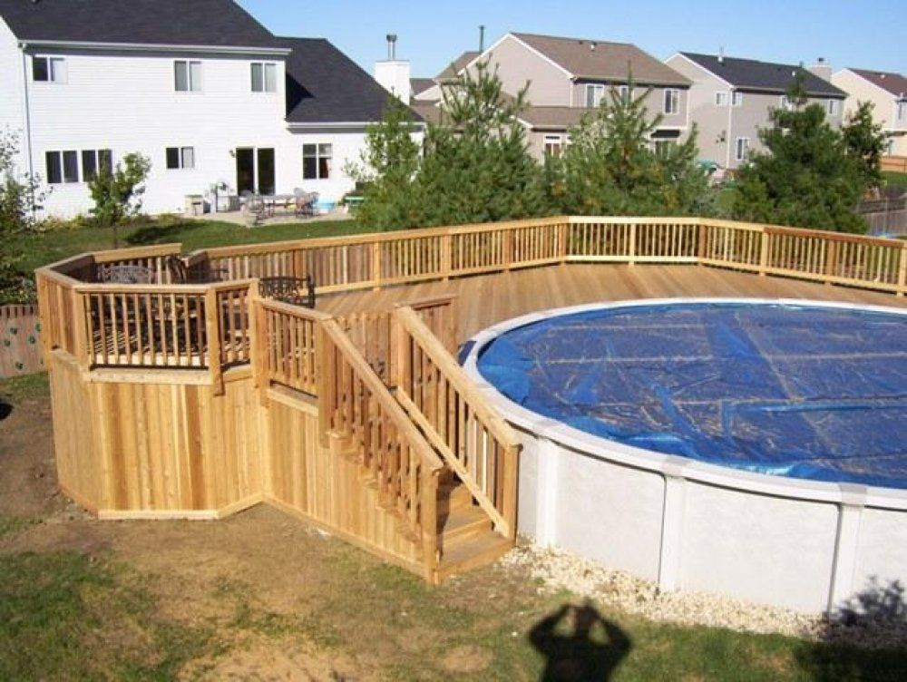 Above ground pool decking options this pool deck wraps for Half in ground pool ideas