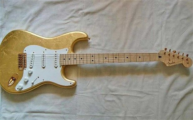 9) Eric Clapton's Gold Leaf Stratocaster Sold for $455,550 This guitar was ordered by Eric Clapton in 1996, around the 50th anniversary of Fender. Clapton wanted something that could hang in a museum, so the company made him a custom fender plated with 23 carat gold