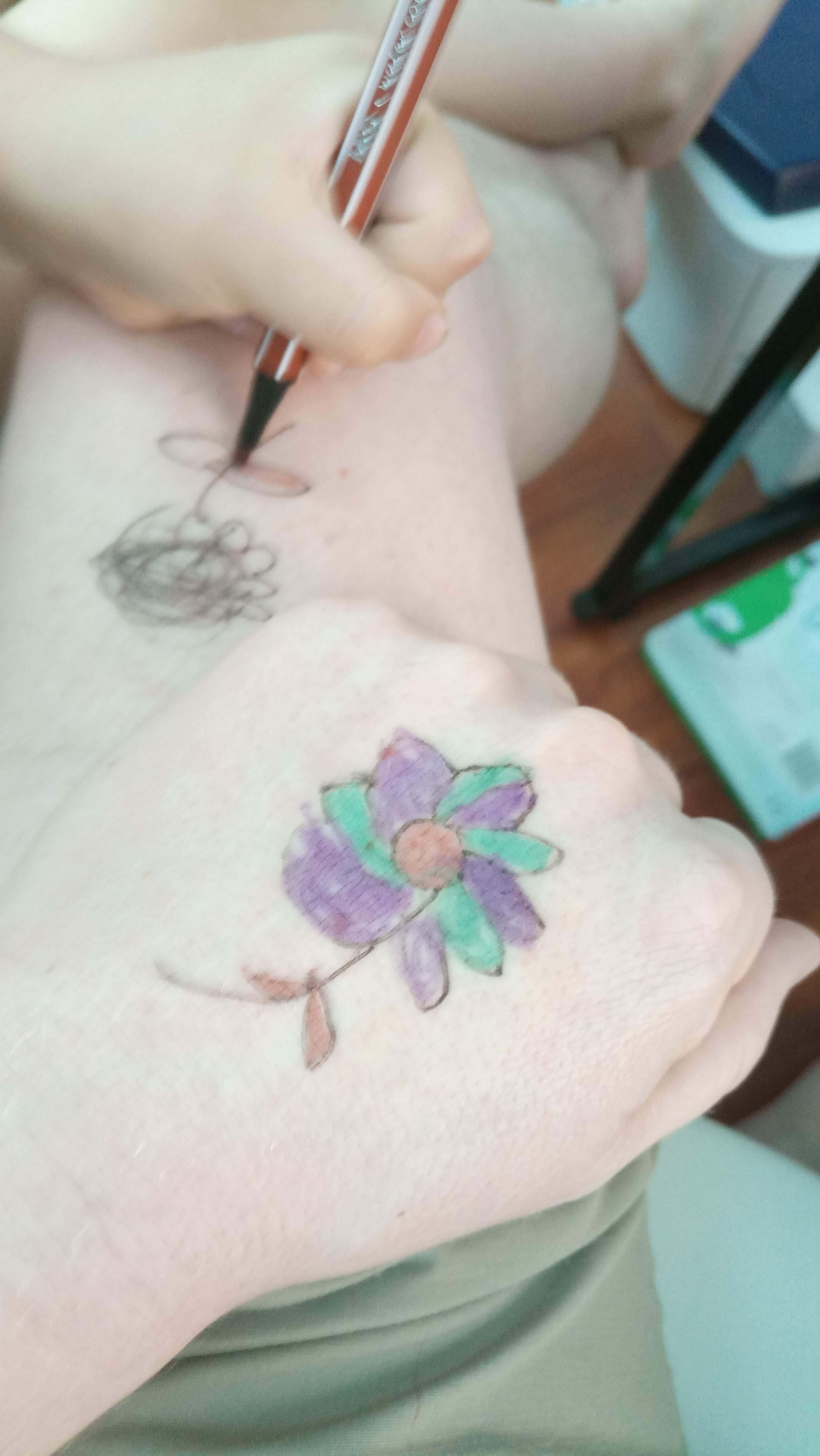 Little one is learning to tattoo