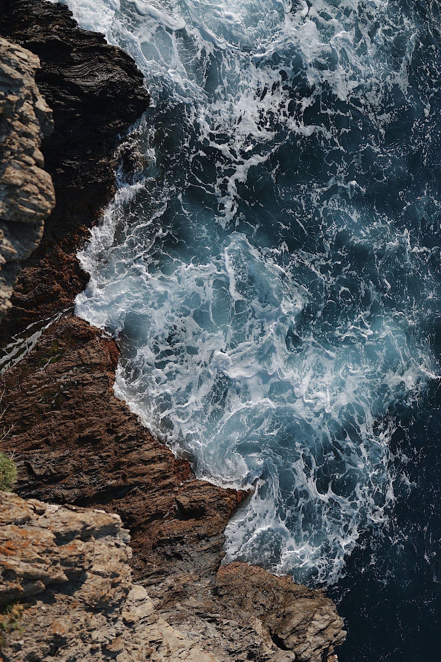 Waves Splashing On Gray Rocky Cliff During Daytime Iphone Wallpaper Sea Ocean Wallpaper Waves Wallpaper Wallpaper beach sea waves rocks coast