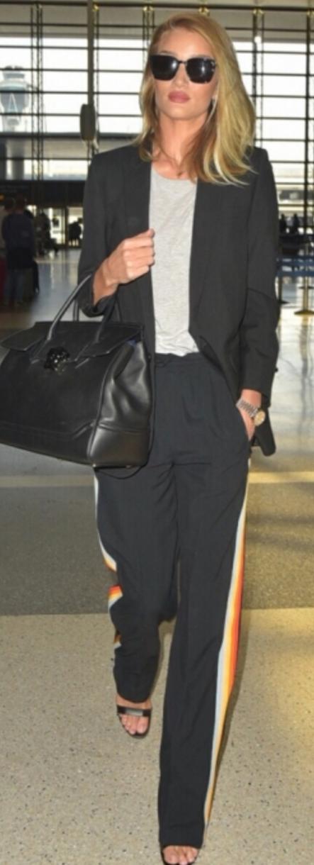 Rosie Huntington-Whiteley: Purse – Vesrsace  Sunglassesa and jacket – Saint Laurent  Shirt – Frame  Pants – Chloe  Shoes – Manolo Blahnik