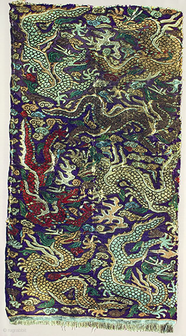 T-0310 A rare antique Central Asian silk kesi panel, woven with seven dragons, surrounded by clouds, on a purple ground.  Circa early 13th century. 57 x 32 cm